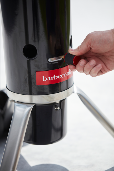 How does an Adam 50 TOP charcoal BBQ work?